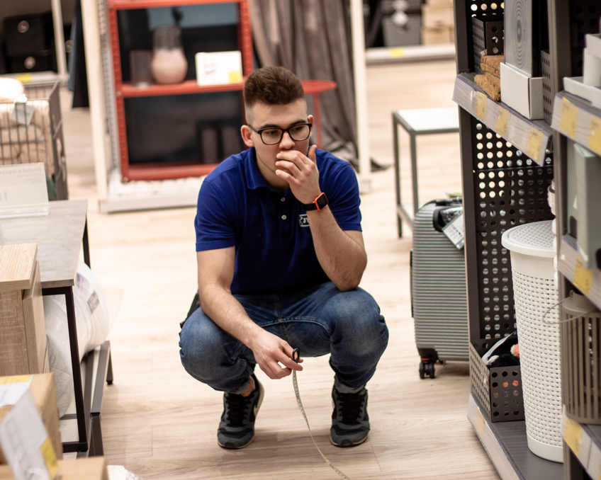 Deputy Store Manager Mikolaj Placzek measures if everything is were it should be