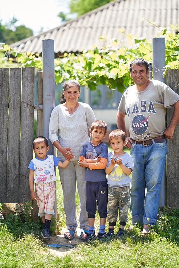 Stoica family and their three children, Gabi (3 years), Ștefan (5 years) and Mădălin (7 years))